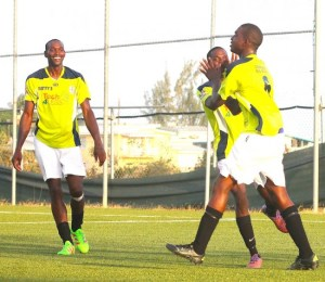 Shaquan Clarke (centre) gave his teammate a high-five after scoring his second goal of the game.