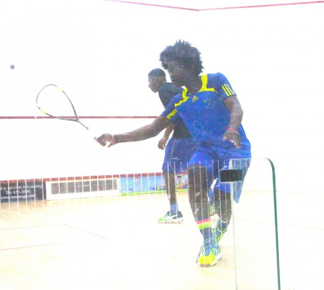 Shemane Griffith plays a backhand shot against Joshua Seale in the under-17 final.