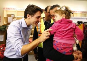 Syrian refugees are greeted by Canada's Prime Minister Justin Trudeau (left) on their arrival from Beirut at the Toronto Pearson International Airport in Mississauga, Ontario, Canada last year.