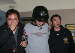 Taiwanese police escorting a man (centre) who allegedly attacked and murdered a toddler on a street in Taipei Monday.