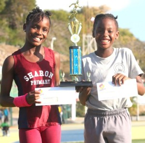 (From left) Samiya Dell of Sharon Primary and Tia Applewhaite  of St Giles tied for victrix ludorum with 30 points.