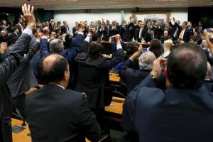 Congressmen of the Brazilian Democratic Movement Party (PMDB) celebrate after announcing that they are withdrawing their support of President Dilma Rousseff's ruling coalition during their National Executive Meeting in Brasilia, Brazil, on Tuesday.