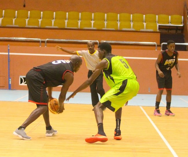 Bulls' Ryan Leacock (with ball) is guarded by Cavs' Joel Hunte while captain Rahim Gibbons (right) awaits a possible pass from his teammate.