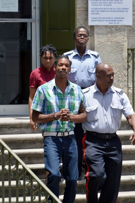 """Lasonta Katrina Gill and her partner Dwayne Marshall leaving the  District """"A"""" Magistrates Court today."""