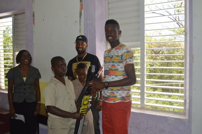 Under-19 champion Shamar Springer (at right) presenting bats to Kyle Jordan, as fellow classmate Shawn Toppin, Corey Collymore and principal Norma Worrell look on.
