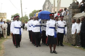 The military procession makes its way into the St Jude's Anglican Church in St George.