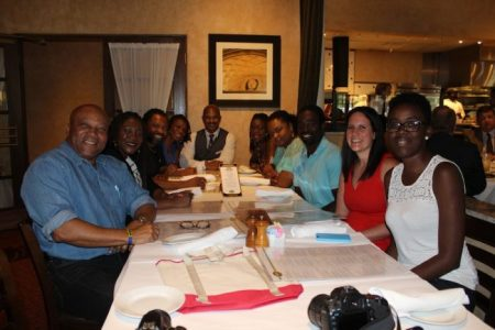 Media officials from Barbados, along with tourism consultant Hugh Foster, host Jessica Savage (second from right) and Andrew Martineau, director of marketing at Westfield Broward Mall (at head of table) having lunch at Brio's, a popular restaurant at the mall.