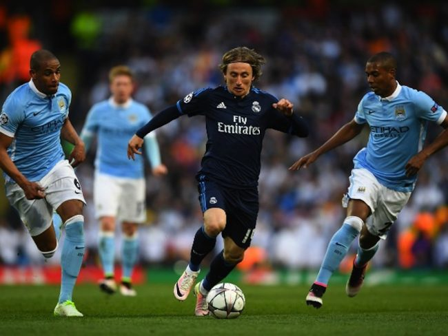 Luka Modric makes a run on the Manchester City goal.