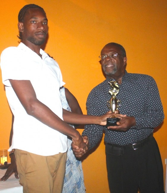 Managing director of IGS Insurance Brokers Tony King presented Rashad Waithe with the Emerging Player of the Year award.