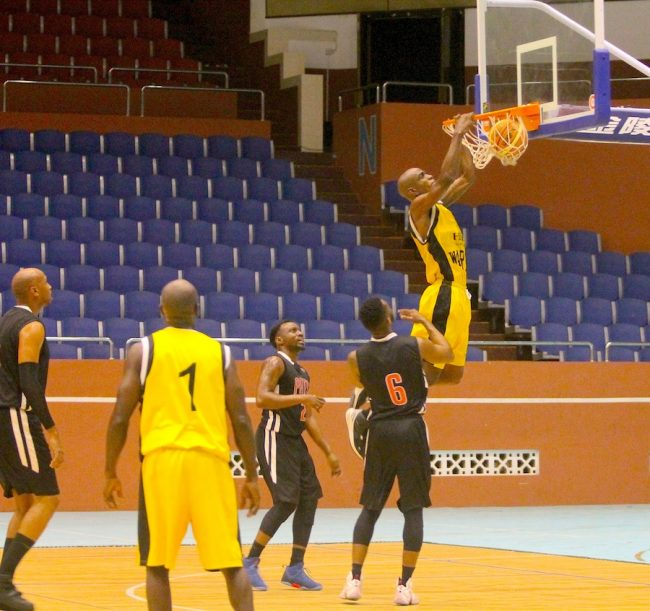 Ricardo Toussaint of Hilton Resort Barbados Warriors  slam dunks during last night's game against Patriots. (Pictures by Morissa Lindsay)
