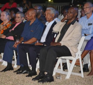 Sir Garfield Sobers (second right) and Sir Wes Hall (right) listening attentively to Eddy Grant.
