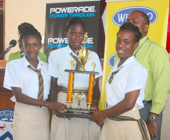 The girls of Christ Church Foundation (from left) Ashantia Phillips, Lelani Haddock and Hannah Connell are all smiles after receiving their 2016 trophy.