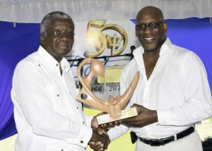 Evan Marshall (at right) receiving the Bim Littfest Lifetime Achievement Award on the behalf of his mother Paule Marshall from Prime Minister Freundel Stuart.