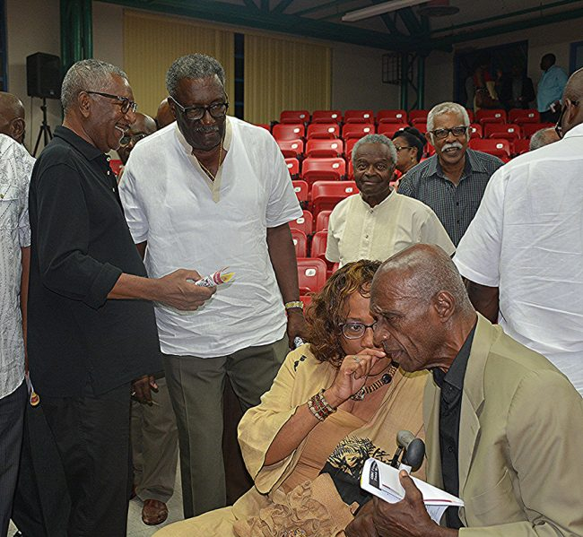 Businessman and former Barbados player Rawle Branker (l), chats with former West Indies captain and now chairman of selectors, Clive Lloyd. In foreground, wife of Rawle Branker, Roxanne Branker, chats with Sir Wes Hall.