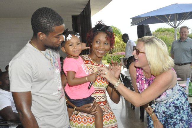 From left, Damien Griffith, his fiancé Janelle Precott holding their daughter Jdae Prescott who was the recipient of Barbados' first cochlear implant, with Trustee of Sandy Lane Charitable Trust Phillipa Challis.