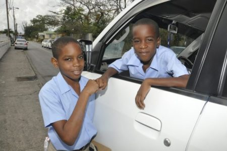 """Dominick Holder (at left) receiving a good luck """"knock"""" from his little brother Davonte Abraham."""