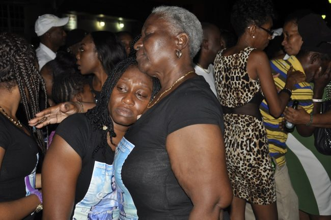 Forde's grieving cousin Susan Forde (left) being comforted by family member Sheila Prescod.