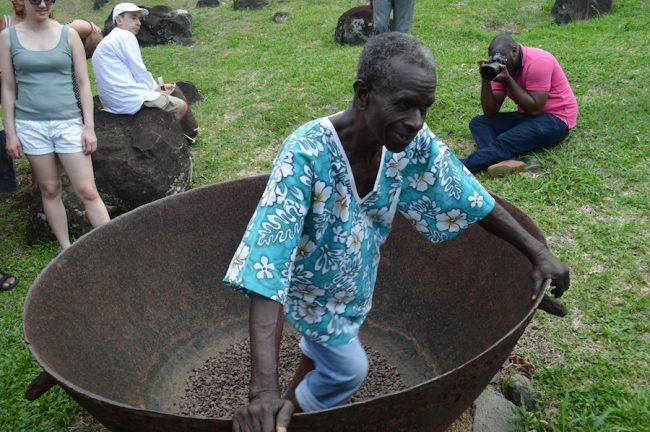 Dancing the cocoa: a worker at Belmont Estate demonstrating the traditional method of polishing cocoa beans.