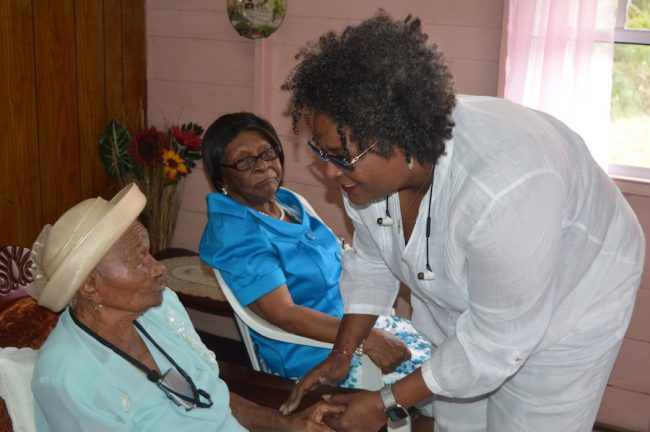 Opposition Leader and MP for St Michael North-East Mia Mottley greeting centenarian Doris Wilkinson.