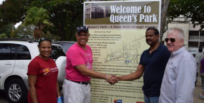 From left, Donna Wellington, managing director for FCIBC Barbados; Mark St Hill, FCIBC regional managing director for retail; Ricardo Marshall, special projects officer for the NCC, and Gary Brown, FCIBC CEO, unveiling one of the three factoid signs posted at the entrances of Queens Park.