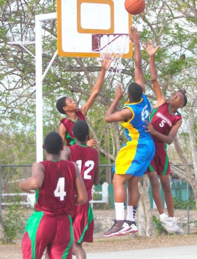 Graydon Sealy's Brandon Rock (right) and Christopher Harewood (left) elevate in their combined effort to defend against Combermere's Krishna Quintyne.