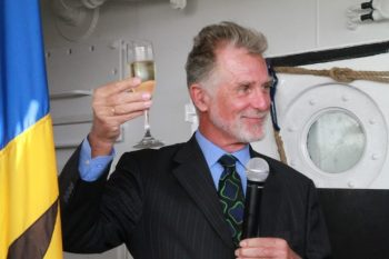 German Ambassador to Barbados Dr Lutz Görgens toasting to 50 more years of cooperation between Barbados and Germany.