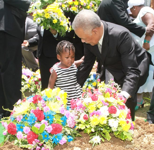 Here Arthur is assisted by his granddaughter Isabella in placing a wreath on the grave.