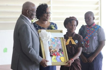 Governor General Sir Elliott Belgrave (left) accepting a gift from Head Girl Christina Watson (second from right) as Principal Angela Smith and Head Boy Jeremiah Nicholls look on.