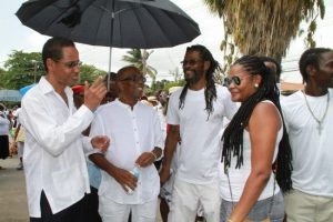 From left, social activist David Comissiong, St Michael East MP Trevor Prescod in conversations with two protesters.