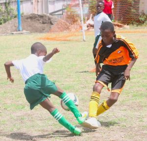 It was the sweetest of dribbles by Christian Collymore of Trinity Academy (in green and white) past Aneko Callender-Mayers of Lawrence T Gay Primary. (Pictures by Morissa Lindsay)
