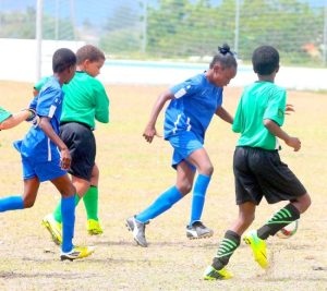 Kerisha Catlyn of St Bartholomew's Primary takes charge of the ball during the game against St Winifred's.