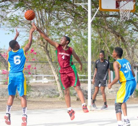 Krishna Quintyne (left) shoots another two of his 15 points while Rico Roberts of Graydon Sealy Secondary attempts to block the shot. (Pictures by Morissa Lindsay)