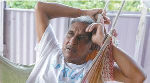 Krishna Ramlal lies in his hammock at his Gopie Trace, Penal, home on Tuesday.