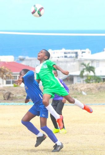 Matthew Alleyne delivered a forceful header to clear the ball away from Azarian Harewood of St Bartholomew's.