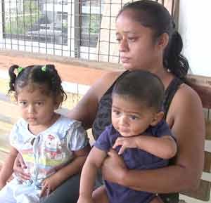 Munesh Churman's wife Tajpatie Suseran and their two children