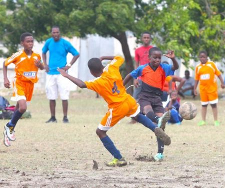Re-shawn Johnson of Wilkie Cumberbatch Primary (r) takes aim while Mario Forde of Belmont Primary challenges.