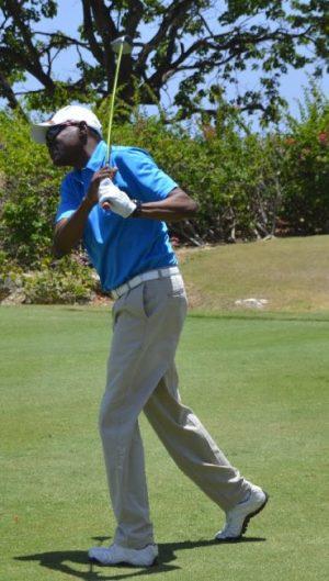 Sagicor General president David Alleyne teeing off during the Golf Scramble.