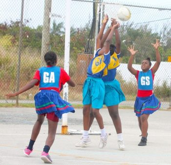 St Stephen's Primary goal-shooter Anisha Smith found it difficult to get ball possession because of St Joseph Primary's defenders.