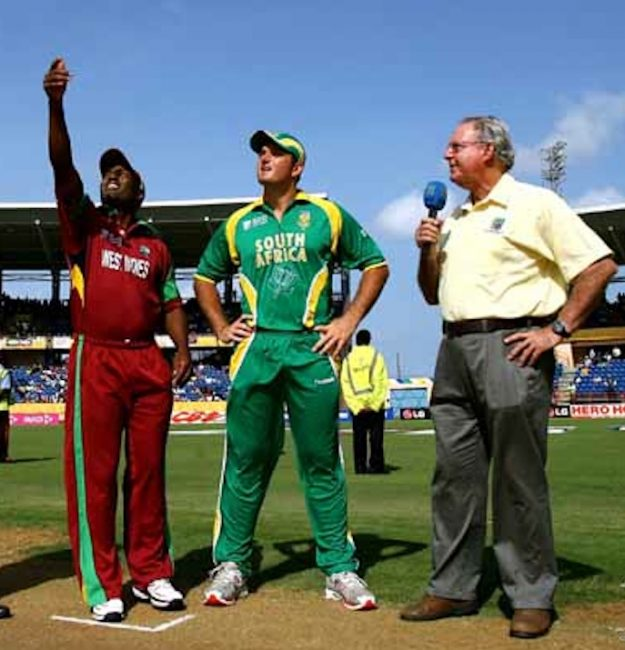 Tony Cozier (right)  as Brian Lara (left) makes the toss during a One-Day International against South Africa.