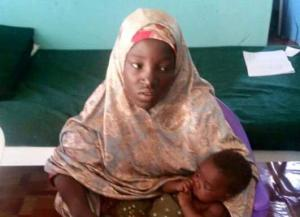 Undated picture released Wednesday by Nigeria army of rescued Chibok schoolgirl and her baby in Maiduguri, Nigeria.