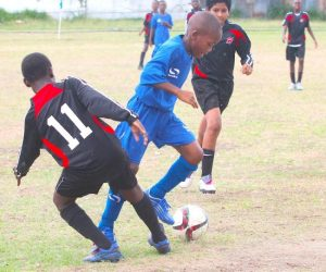 Wesley Hall Primary's goal-scorer Kevion Newton took on Eagle Hall Primary defender Joshua Hope and won the battle.
