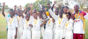 Combermere repeat as kings of the Barbados Cricket Association's Everton Weekes Under-13 Cricket Tournament. Player of the match Nimar Bolden (fourth right) holds trophy with captain Reuben Agard. (Pictures by Morissa Lindsay).