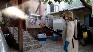 A health worker fumigates an area in Gama, Brazil, to combat the Aedes aegypti mosquito in February.