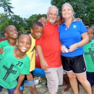 Teri and Harold Nichols with some Jamaican children.
