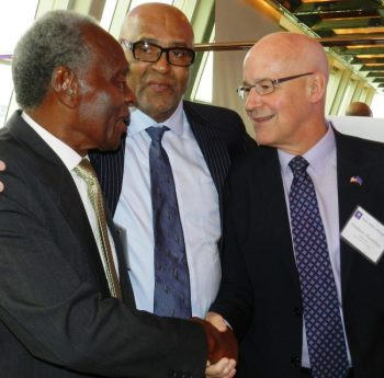 Jim Wedderburn (at left) being congratulated by New York University president Andrew Hamilton as Olympian Dr Cliff Bertrand looks on.