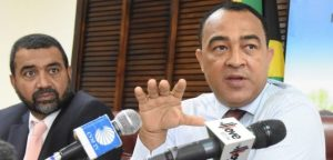 Minister of Health Dr Christopher Tufton (right) with Chief Medical Office Dr Winston De La Haye.