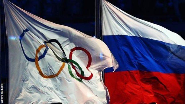 _90021537_olympicflagrussiaflag