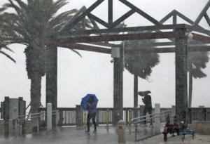 Beach goers get caught in a sudden downpour when a band associated from Tropical Storm Colin came ashore at Clearwater Beach on Monday.