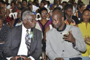 Prime Minister Freundel Stuart (left) in conversation with Principal of Reynold Weekes Primary School Anderson Bishop at the school's 2016 graduation ceremony.