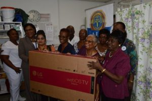 From left at front, Nurse Virginia Broomes and  Haematology Department head Theresa Laurent  with MLLF members vice president Santri Dukhna-Bridgeman, Grace Muller, president Hyacinth Grimes, secretary Patricia Farley. At back are Trevor Springer, Marcia Small, PRO Daphne Springer and Blenda Springer.